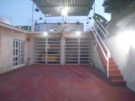 Casa de  2 cuartos, 2 baños y 1 garaje por $ 85.000 en Boyeros, La Habana